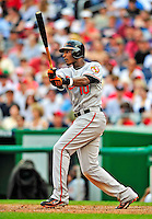 24 May 2009: Baltimore Orioles' center fielder Adam Jones hits a two-run homer in the seventh inning against the Washington Nationals at Nationals Park in Washington, DC. The Nationals rallied to defeat the Orioles 8-5 and salvage a win in their interleague series. Mandatory Credit: Ed Wolfstein Photo