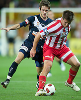MELBOURNE, AUSTRALIA - DECEMBER 11: Michael Marrone of the Heart and Mate Dugandzic of the Victory compete for the ball during the round 18 A-League match between the Melbourne Heart and Melbourne Victory at AAMI Park on December 11, 2010 in Melbourne, Australia. (Photo by Sydney Low / Asterisk Images)
