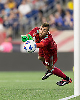 Foxborough, Massachusetts - June 30, 2018: In a Major League Soccer (MLS) match, New England Revolution (blue/white) defeated D.C. United (white/gray/red), 3-2, at Gillette Stadium.<br /> Save.