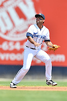Asheville Tourists shortstop Coco Montes (5) reacts to the ball during a game against the Lakewood BlueClaws at McCormick Field on June 16, 2019 in Asheville, North Carolina. The BlueClaws defeated the Tourists 6-5. (Tony Farlow/Four Seam Images)