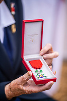 BNPS.co.uk (01202 558833)<br /> Pic: MaxWillcock/BNPS<br /> <br /> Pictured: Lorna Cockayne holding the prestigious Legion d'Honneur.<br /> <br /> A brilliant Bletchley Park codebreaker who enabled the Allies to read crucial messages before Adolf Hitler received them has today been awarded the prestigious Legion d'Honneur.<br /> <br /> Lorna Cockayne, now aged 96, worked on the 'Colossus' computer which cracked the Lorenz code used by German generals to brief the Nazi leader.<br /> <br /> She fed in tape and counted letters to decipher intercepted messages for eight hours daily without a break as the giant machine never stopped.<br /> <br /> The intelligence she uncovered was particularly important in the lead-up to the D-Day landings in June 1944.