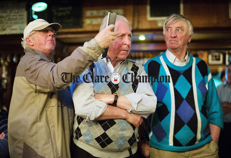 Interested parties on the sideline during a session as part of the Sean Nos and Trad festival at O Connor's Pub in Doolin. Photograph by John Kelly.