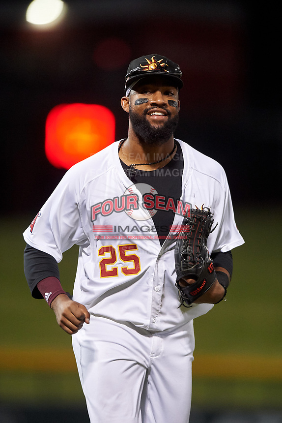 Mesa Solar Sox left fielder Jo Adell (25), of the Los Angeles Angels organization, jogs off the field between innings of an Arizona Fall League game against the Scottsdale Scorpions on September 18, 2019 at Sloan Park in Mesa, Arizona. Scottsdale defeated Mesa 5-4. (Zachary Lucy/Four Seam Images)