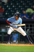 NW Arkansas shortstop Raul Mondesi (2) fakes a bunt during a game against the San Antonio Missions on May 30, 2015 at Arvest Ballpark in Springdale, Arkansas.  San Antonio defeated NW Arkansas 5-2.  (Mike Janes/Four Seam Images)