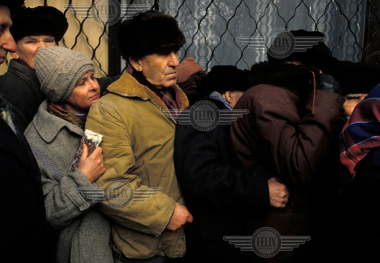 Chechens queue for food before the Russian attack..In December 1994 Russian troops entered Chechnya in an attempt to quash the countryÕs independence movement.  Early promises of a quick victory were soon silenced as the Chechens put up fierce resistance to the Russian assault and the death toll mounted.  Up to 100,000 people Ð many of them civilians Ð are estimated to have been killed in the 20 month war that followed.