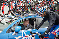 Mirko Selvaggi (ITA/Wanty-Groupe Gobert) gets back to DS Hilaire Van der Schueren (BEL/Wanty-Groupe Gobert) for some more rain gear<br /> <br /> 70th Dwars Door Vlaanderen 2015