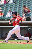 Birmingham Barons second baseman Gordon Beckham (15), on rehab assignment from the Chicago White Sox, at bat during a game against the Tennessee Smokies on April 21, 2014 at Regions Field in Birmingham, Alabama.  Tennessee defeated Birmingham 10-5.  (Mike Janes/Four Seam Images)