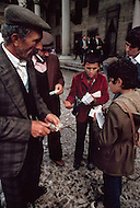 December 1978, Istanbul, Turkey. In Istanbul some children devote themselves to any business they can find in the street, working alongside and against adults. Here two young boys are seen selling cigarettes and lottery tickets.g - Child labor as seen around the world between 1979 and 1980 - Photographer Jean Pierre Laffont, touched by the suffering of child workers, chronicled their plight in 12 countries over the course of one year.  Laffont was awarded The World Press Award and Madeline Ross Award among many others for his work.