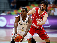 BELGRADE, SERBIA - JULY 06: Hermenegildo Santos (L) of Angola in action against Milos Teodosic (R) of Serbia during the 2016 FIBA World Olympic Qualifying basketball Group A match between Angola and Serbia at Kombank Arena on July 06, 2016 in Belgrade, Serbia. (Photo by Srdjan Stevanovic/Getty Images)