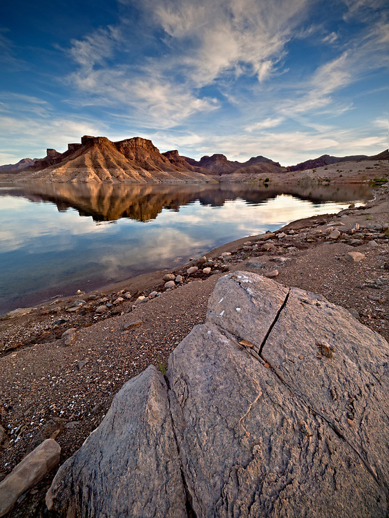 """The setting sun illuminates an unnamed volcanic rock formation lined with the """"Bathtub Ring"""" in Gateway Cove on Lake Mead in the Lake Mead National Recreation Area on the Arizona-Nevada border (Photo from Arizona)"""