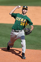 Siena Saints pitcher Ed Lewicki #26 delivers a pitch during a game against the UCF Knights at the UCF Baseball Complex on March 4, 2012 in Orlando, Florida.  Central Florida defeated Siena 15-2.  (Mike Janes/Four Seam Images)