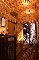 A wine cellar with precious bottles guarded behind iron bars in an old vaulted cellar. Stockholm, Sweden, Sverige, Europe