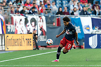 FOXBOROUGH, MA - JUNE 23: Tajon Buchanan #17 of New England Revolution brings the ball forward during a game between New York Red Bulls and New England Revolution at Gillette Stadium on June 23, 2021 in Foxborough, Massachusetts.