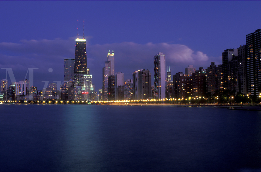 Chicago, Illinois, A view of the skyline of downtown Chicago from the waters of Lake Michigan at dusk.