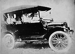 A family rides in an old jalopy.