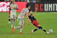 WASHINGTON, DC - SEPTEMBER 12: Kevin Paredes #30 of D.C. United battles for the ball with Sean Nealis #15 of New York Red Bulls during a game between New York Red Bulls and D.C. United at Audi Field on September 12, 2020 in Washington, DC.