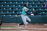 Jonathan Ornelas (3) of the Llamas de Hickory follows through on his swing against the Winston-Salem Rayados at Truist Stadium on July 6, 2021 in Winston-Salem, North Carolina. (Brian Westerholt/Four Seam Images)
