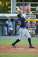 Austin Riley (13) of the Danville Braves follows through on his swing against the Burlington Royals at Burlington Athletic Park on August 13, 2015 in Burlington, North Carolina.  The Braves defeated the Royals 6-3. (Brian Westerholt/Four Seam Images)