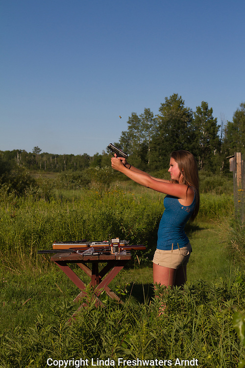 Young woman shooting a Ruger .40 S&W
