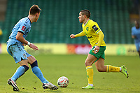 9th January 2021; Carrow Road, Norwich, Norfolk, England, English FA Cup Football, Norwich versus Coventry City; Emi Buendia of Norwich City cuts inside the challenge from Leo Ostigard of Coventry City
