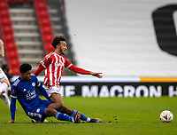 9th January 2021; Bet365 Stadium, Stoke, Staffordshire, England; English FA Cup Football, Carabao Cup, Stoke City versus Leicester City; Jacob Brown of Stoke City is slide tackled by Wesley Fofana of Leicester City leading to a booking for Fofana
