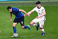 11th July 2021; Wembley Stadium, London, England; 2020 European Football Championships Final England versus Italy; Federico Chiesa holds off Declan Rice (Eng)