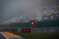 29th August 2021; Spa Francorchamps, Stavelot, Belgium: FIA F1 Grand Prix of Belgium,  race day: Red Flag displayed due to race stoppage and fans  during the formation laps in heavy rain before cancellation of the race due to standing water