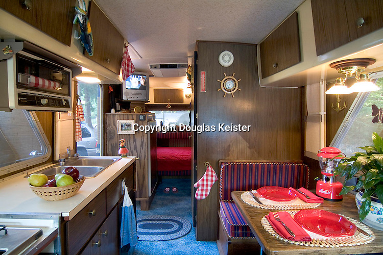The interior of the Glastron is a study in compact functionality. Product literature states that the Glaston sleeps six comfortably in 3 double beds, has a gas/electric refrigerator, 12-volt and 110-volt power, and fully self-contained bathroom. By the 1970s, most travel trailers and motorhomes had plastic veneers applied to particleboard, thus this Glastron is a real gem since its interior is sheathed in red oak.