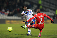 Bafetimbi Gomis (Lyon) vs Helder (Nancy)  .Football Calcio 2012/2013.Ligue 1 Francia.Foto Panoramic / Insidefoto .ITALY ONLY