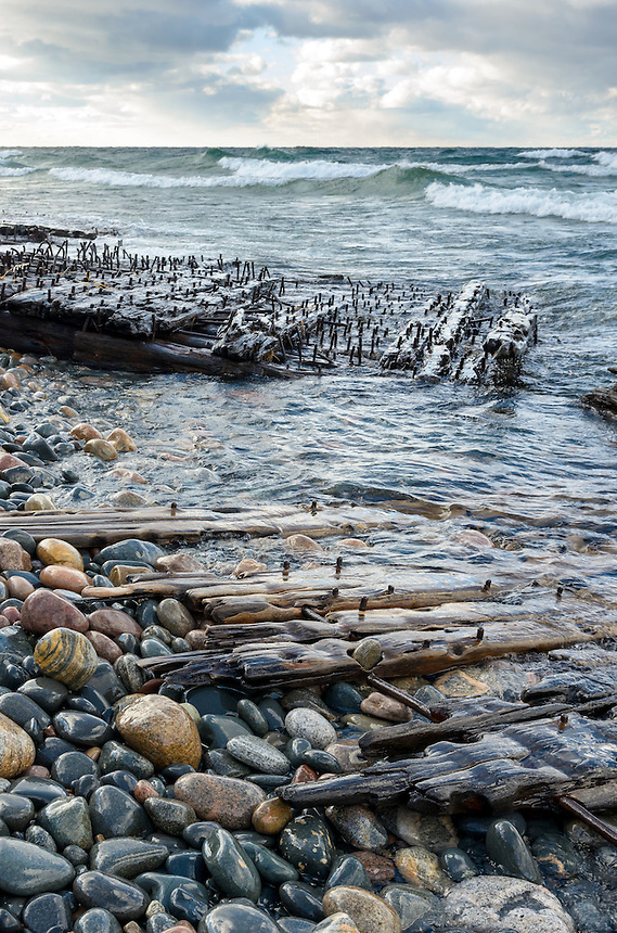 Shipwreck remains along the cold, rocky Lake Shoreline on a blustery day. Pictured Rocks National Lakeshore - Grand Marais, MI