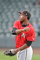 Outfielder Micker Adolfo (37) of the Kannapolis Intimidators warms up before a game against the Greenville Drive on Thursday, Aug. 18, 2016, at Fluor Field at the West End in Greenville, South Carolina. Greenville won, 2-0. (Tom Priddy/Four Seam Images)