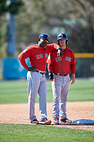 Boston Red Sox coach Carlos Febles (left) and Cole Sturgeon (41) during a minor league Spring Training game against the Baltimore Orioles on March 16, 2017 at the Buck O'Neil Baseball Complex in Sarasota, Florida. (Mike Janes/Four Seam Images)