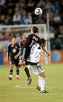 DC United defender Jed Zayner (12) goes above LA Galaxy forward Jovan Kirovski (9) to head ball during the first half of the game between LA Galaxy and the D.C. United at the Home Depot Center in Carson, CA, on September 18, 2010. LA Galaxy 2, D.C. United 1.