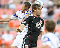Carey Talley #8 of D.C.United and Jimmy Conrad #12 of the Kansas City Wizards up for a header during an MLS match at RFK Stadium on May 5 2010, in Washington DC. United won 2-1
