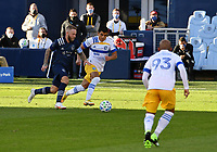 KANSAS CITY, KS - NOVEMBER 22: Johnny Russell #7 of Sporting KC dribbles upfield as Nick Lima #24 of the San Jose Earthquakes tries to stop him before a game between San Jose Earthquakes and Sporting Kansas City at Children's Mercy Park on November 22, 2020 in Kansas City, Kansas.