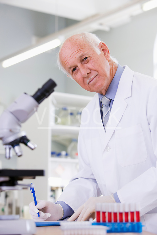 Male scientist doing research in laboratory, portrait