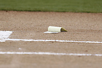 July 10, 2009:  The Tampa Yankees lineup card sits on the ground after manager Luis Sojo threw it to the ground when ejected by home plate umpire Jordan Ferrell before a game at George M. Steinbrenner Field in Tampa, FL.  Tampa is the Florida State League High-A affiliate of the New York Yankees.  Photo By Mike Janes/Four Seam Images