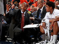 CHARLOTTESVILLE, VA- NOVEMBER 26:  Virginia Cavalier assistant coach Ron Sanchez  talks with Jontel Evans #1 of the Virginia Cavaliers during the game on November 26, 2011 at the John Paul Jones Arena in Charlottesville, Virginia. Virginia defeated Green Bay 68-42. (Photo by Andrew Shurtleff/Getty Images) *** Local Caption *** Jontel Evans;Ron Sanchez
