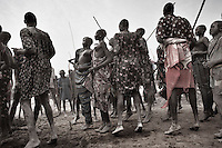 South Sudan. 23 March 2011...Young Dinkas dancing near the Nile in a cattle camp following the herds in areas that maintain water and pasture during the dry season..