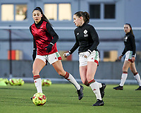 Amber Tysiak (3) of OHL and Marie Detruyer (17) of OHL in action during the warm up before a female soccer game between Oud Heverlee Leuven and RSC Anderlecht on the 12 th matchday of the 2020 - 2021 season of Belgian Womens Super League , sunday 31 st of January 2021  in Heverlee , Belgium . PHOTO SPORTPIX.BE | SPP | SEVIL OKTEM