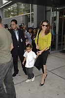 NEW YORK - OCTOBER 10, 2007: A very skinny looking Angelina Jolie,  picks up son Maddox Jolie-Pitt at his private school on October 10, 2007 in New York City <br /> <br /> <br /> People:  Angelina Jolie; Maddox Jolie-Pitt
