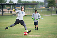 Fletcher Phillips of Springdale demonstrates a kick for his brother-in-law Adalberto Favila, 14, Monday Aug. 2, 2021 at Bobby Hopper Park in Springdale. Phillips drew on his experience playing soccer for Springdale to coach Favila and his brother Jose Flavia (not pictured). Visit nwaonline.com/21000803Daily/ and nwadg.com/photo. (NWA Democrat-Gazette/J.T. Wampler)