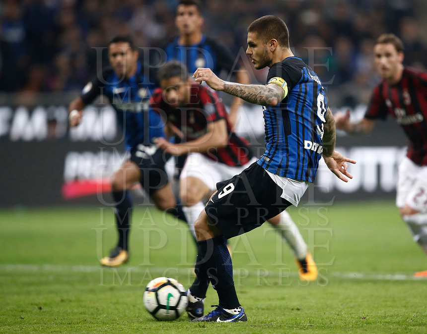 Calcio, Serie A: Milano, stadio Giuseppe Meazza, 15 ottobre 2017.<br /> Inter's Mauro Icardi captain kicks a penalty  and scores for the third time during the Italian Serie A football match between Inter and Milan at Giuseppe Meazza (San Siro) stadium, October15, 2017.<br /> UPDATE IMAGES PRESS/Isabella Bonotto