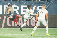 FOXBOROUGH, MA - NOVEMBER 1: Alexander Buttner #28 of New England Revolution crosses the ball as Oniel Fisher #91 of DC United leaps to intercept during a game between D.C. United and New England Revolution at Gillette Stadium on November 1, 2020 in Foxborough, Massachusetts.