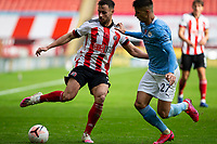 31st October 2020; Bramall Lane, Sheffield, Yorkshire, England; English Premier League Football, Sheffield United versus Manchester City; George Baldock of Sheffield United cuts the ball back under pressure from Joao Cancelo of Manchester City