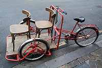 Two chairs on a red rickshaw, Old Bordeaux City, France.