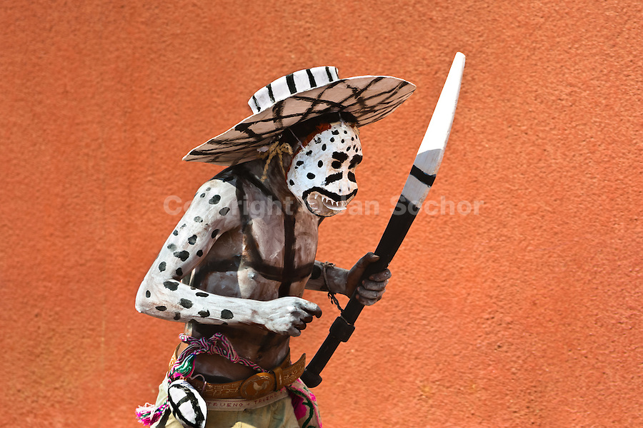 """A Cora Indian man, wearing a demon mask, runs during the religious ritual celebration of Semana Santa (Holy Week) in Jesús María, Nayarit, Mexico, 21 April 2011. The annual week-long Easter festivity (called """"La Judea""""), performed in the rugged mountain country of Sierra del Nayar, merges indigenous tradition (agricultural cycle and the regeneration of life worshipping) and animistic beliefs with the Christian dogma. Each year in the spring, the Cora villages are taken over by hundreds of wildly running men. Painted all over their semi-naked bodies, fighting ritual battles with wooden swords and dancing crazily, they perform demons (the evil) that metaphorically chase Jesus Christ, kill him, but finally fail due to his resurrection. La Judea, the Holy Week sacred spectacle, represents the most truthful expression of the Coras' culture, religiosity and identity."""