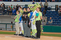 Opening Night Rancho Cucamonga Quakes Mascots Tremor and After Shock along with Home plate umpire Darius Ghani and Base umpire Andrew Barrett stand behind home plate during National Anthem at LoanMart Field on April 12, 2018 in Rancho Cucamonga, California. The 66ers defeated the Quakes 5-4.  (Donn Parris/Four Seam Images)