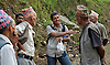 Ram Kumar Bhandari speaking with road workers near his home village in Besishahar Lamjung.  Conversation spanned from victim's rights, workers rights and the poor situation of employment in Nepal to trade with China and the benefit that Nepali people could gain from a more liberal trade policy.