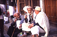 Yemen Sana'a,.men , traditional dressed, sitted and talking in the big quare